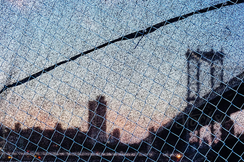 Manhattan Bridge behind a metal grate at twilight by Good Vibrations Images for Stocksy United