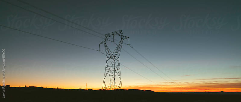 Electric tower at sunset by Javier Pardina for Stocksy United