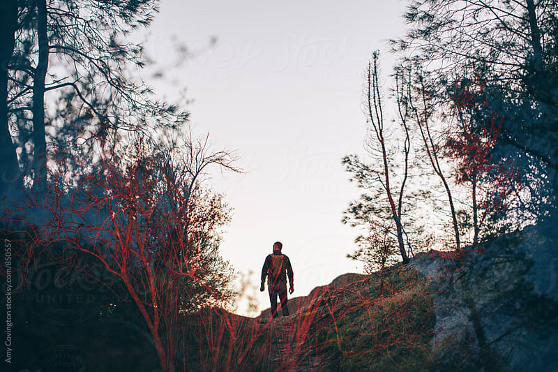 Double exposure of a man hiking from behind by Amy Covington for Stocksy United