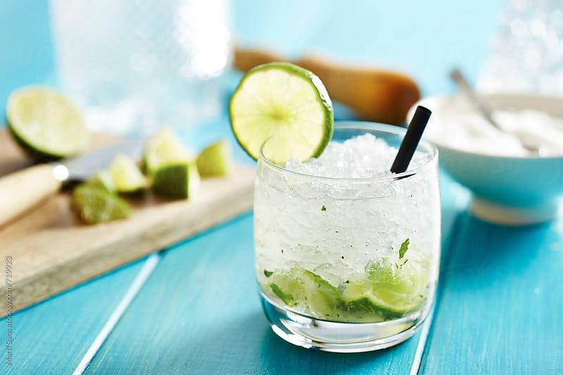 Homemade caipirinha cocktail by Martí Sans for Stocksy United