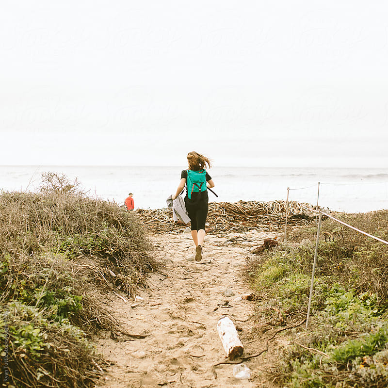 Running to the beach by Ryan Tuttle for Stocksy United