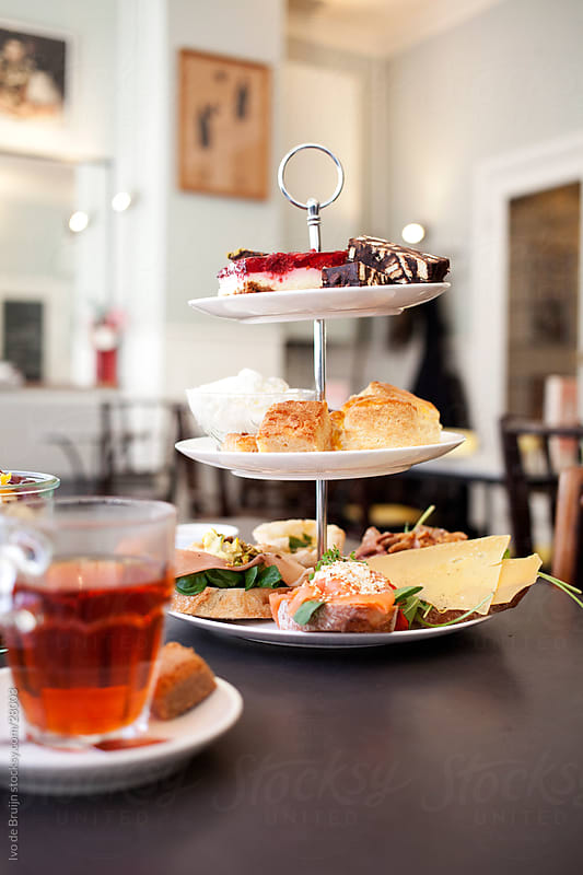 High tea food being served on a table by Ivo de Bruijn for Stocksy United