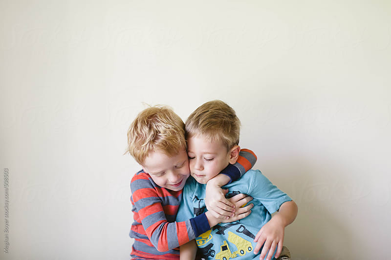 young brothers being silly together by Meghan Boyer for Stocksy United