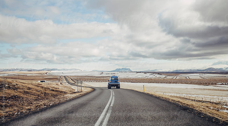 4WD vehicle driving on road in Iceland by Soren Egeberg for Stocksy United