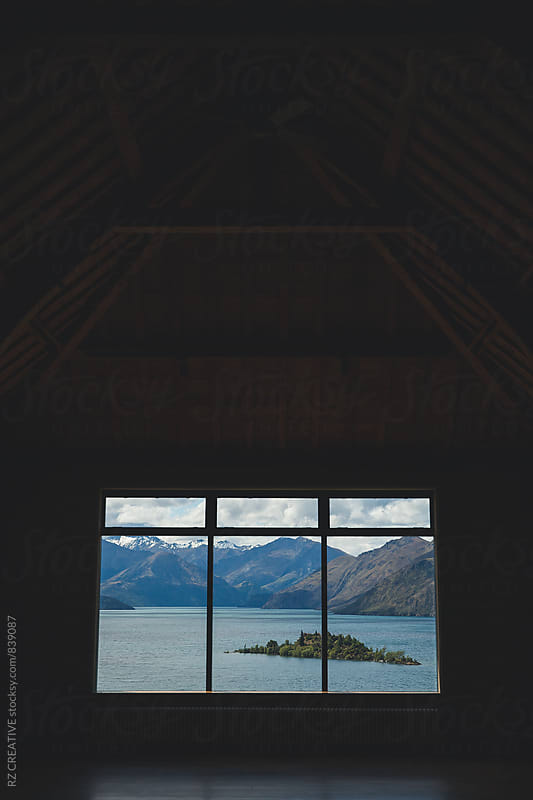 Mountain view through barn window. by RZ CREATIVE for Stocksy United