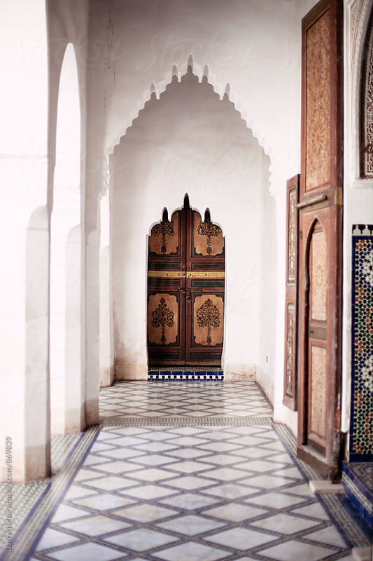 Ornate archway and door with tiled floors in Bahia palace in Marrakech. by Darren Muir for Stocksy United