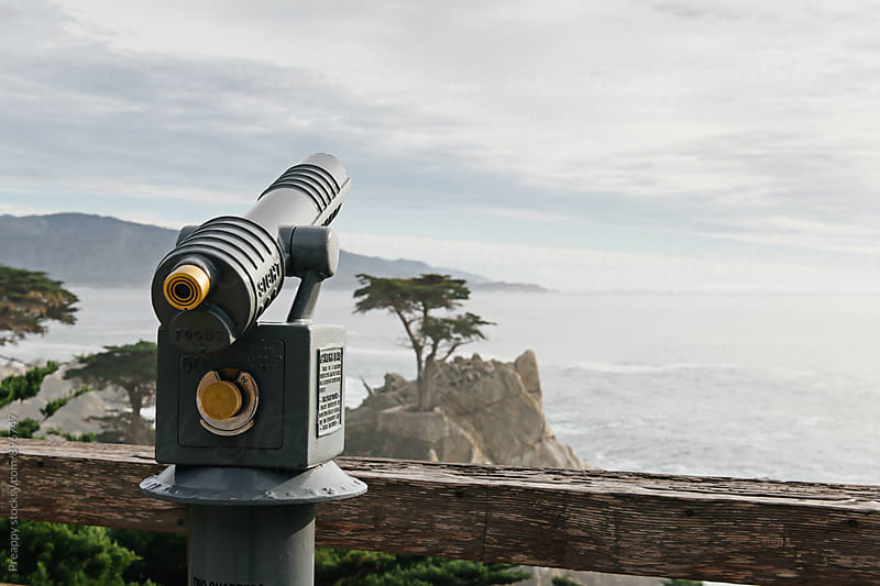 Tourist telescope looking out to lonely cypress tree by Preappy for Stocksy United