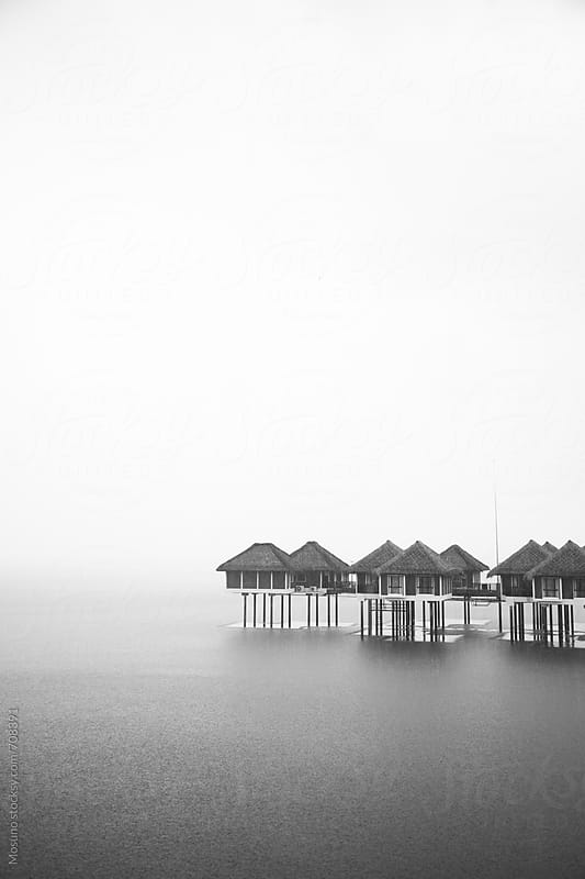 Small Houses Built on the Water Surrounded by the Fog by Mosuno for Stocksy United