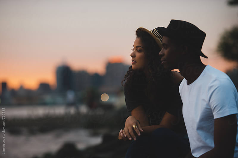 Couple watching the sunset by Lauren Naefe for Stocksy United