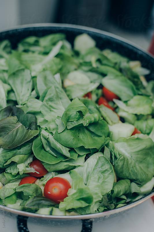 big green salad by Lydia Cazorla for Stocksy United
