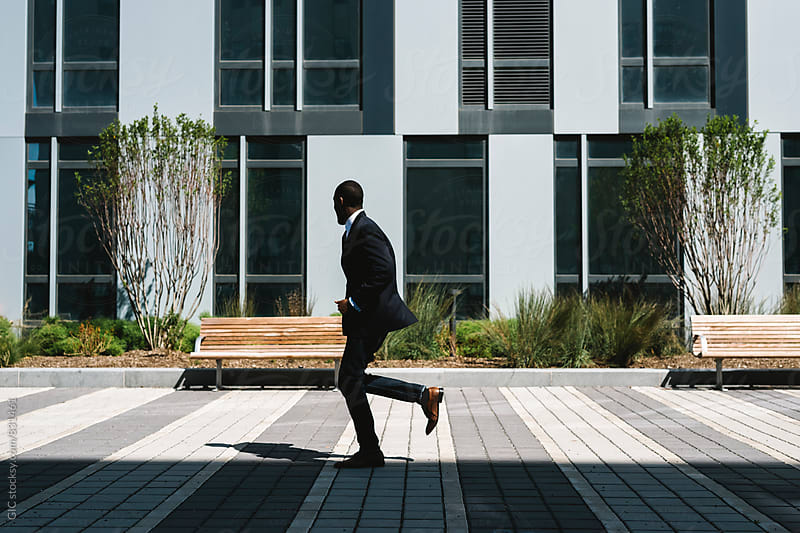 Cool black businessman in the city by GIC for Stocksy United