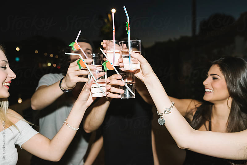 Friends toasting in a night party by WAVE for Stocksy United