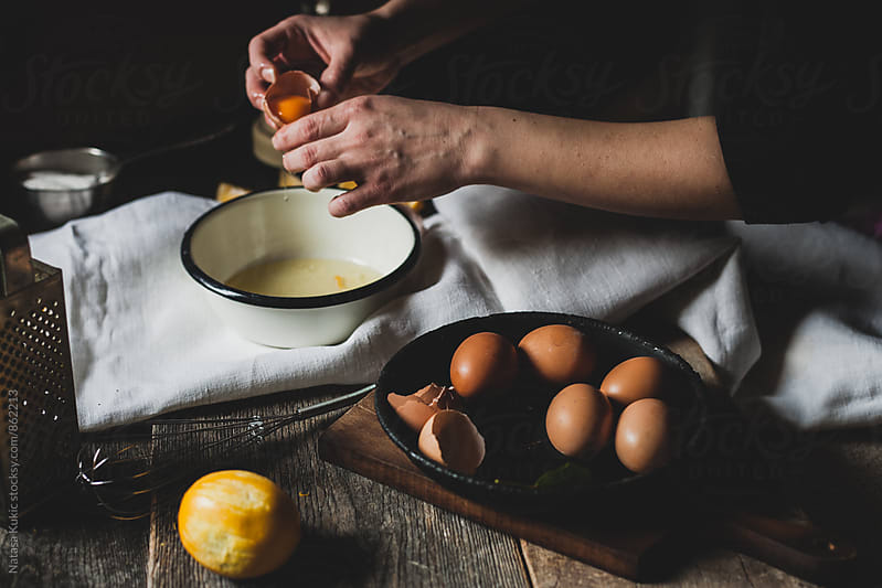 Separating eggs by Natasa Kukic for Stocksy United