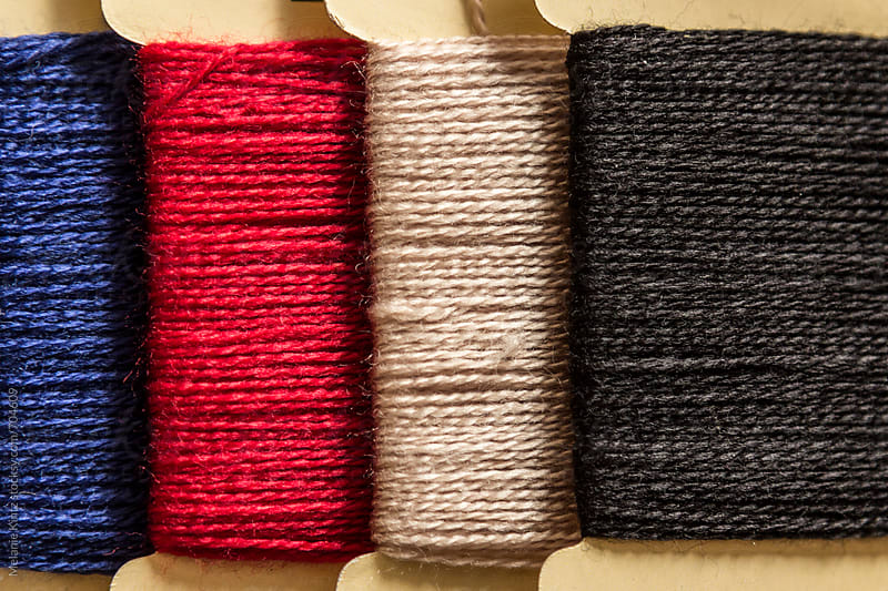 Four rolls of yarn by Melanie Kintz for Stocksy United