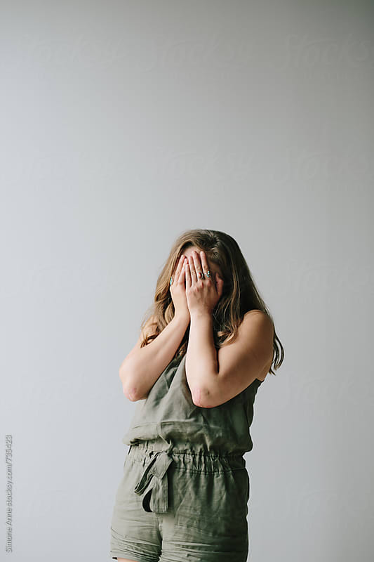 Girl in green jumper by Simone Anne for Stocksy United