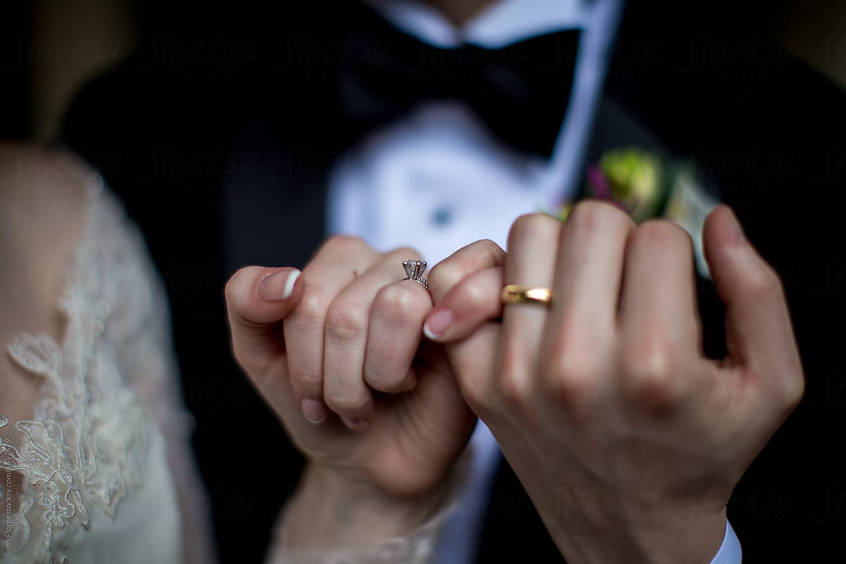Wedding Couple Holding Hands Showing Off Rings | Stocksy ...