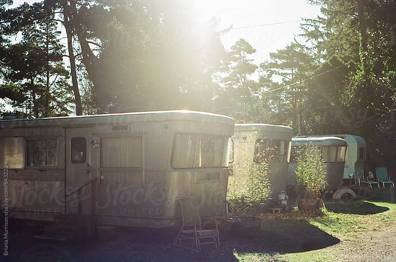 A Row of Vintage Trailers in the Sunshine by Briana Morrison for Stocksy United