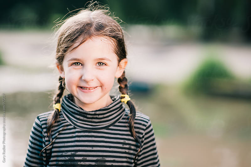 Preschooler Girl with Plaits Looking at Camera by Gary Radler Photography for Stocksy United