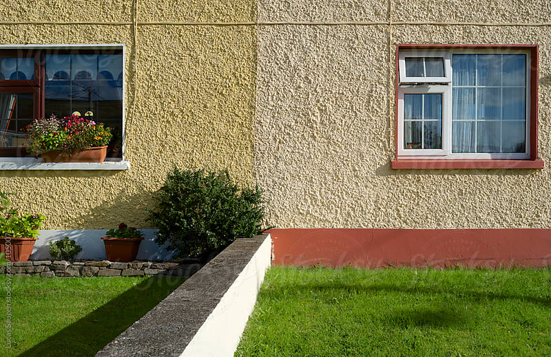 A row house in Dingle, Ireland. by Lucas Saugen for Stocksy United