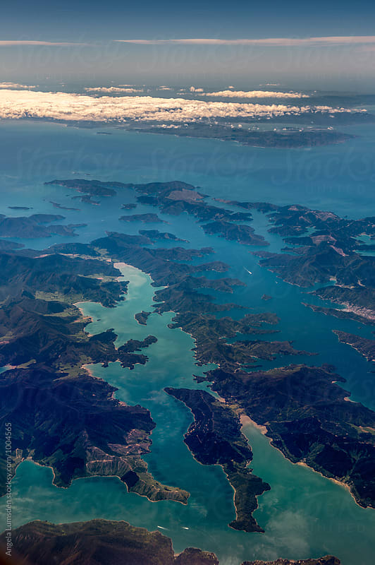 Aerial view of Kenepuru Sound and Queen Charlotte Sound (Totaranui) at the tip of the South Island, Cook Strait and Wellington at the bottom of the North Island on a clear day by Angela Lumsden for Stocksy United