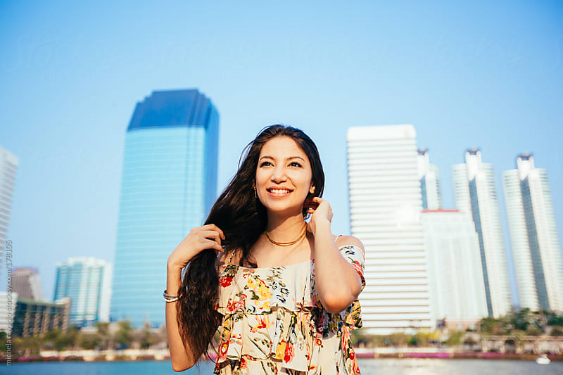 Young beautiful woman enjoying the city by michela ravasio for Stocksy United