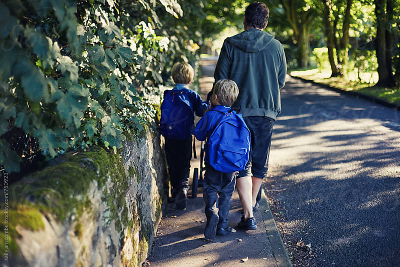 Father and children walking to school together by sally anscombe for Stocksy United