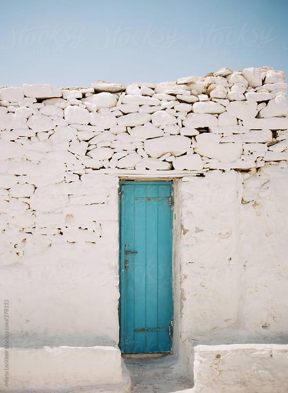 Tuquoise blue doorways in Mykonos, Greece by Marta Locklear for Stocksy United