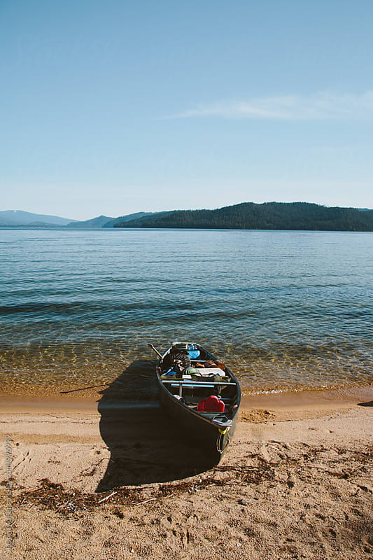 Canoe loaded with camping gear by Justin Mullet for Stocksy United