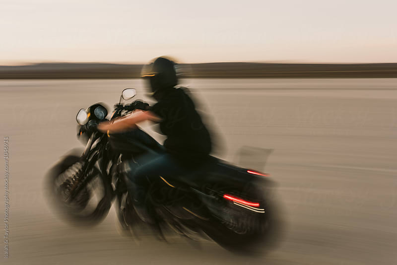 Woman Riding Motorcycle by Isaiah & Taylor Photography for Stocksy United