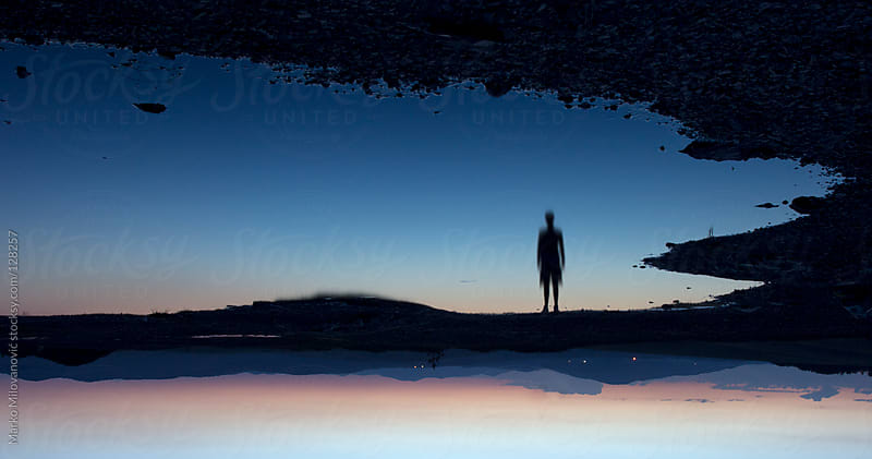 Reflection of a man silhouette in water by Marko Milovanović for Stocksy United