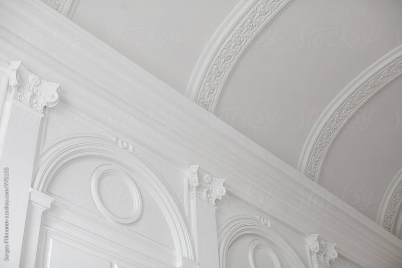 White ceiling with old moldings by Sergey Filimonov for Stocksy United
