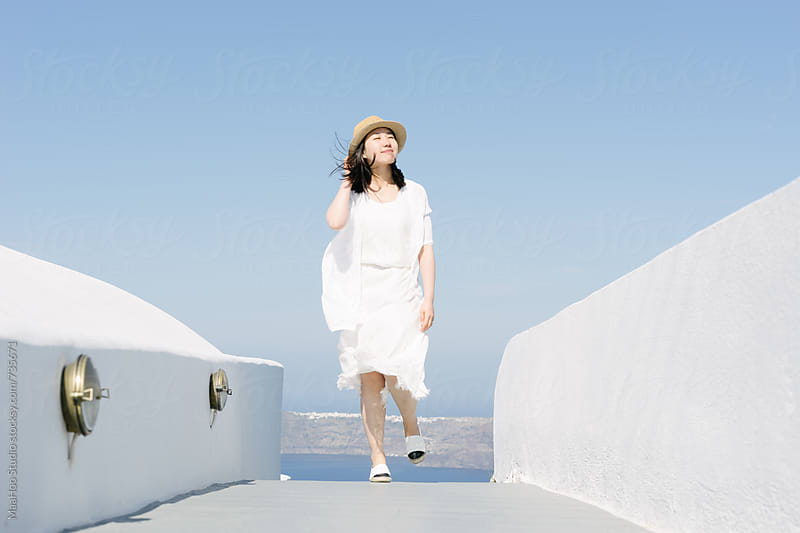 Beautiful chinese girl in Santorini by MaaHoo Studio for Stocksy United