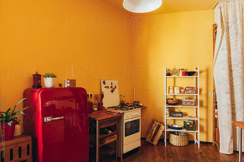 Yellow Kitchen by Julien L. Balmer for Stocksy United