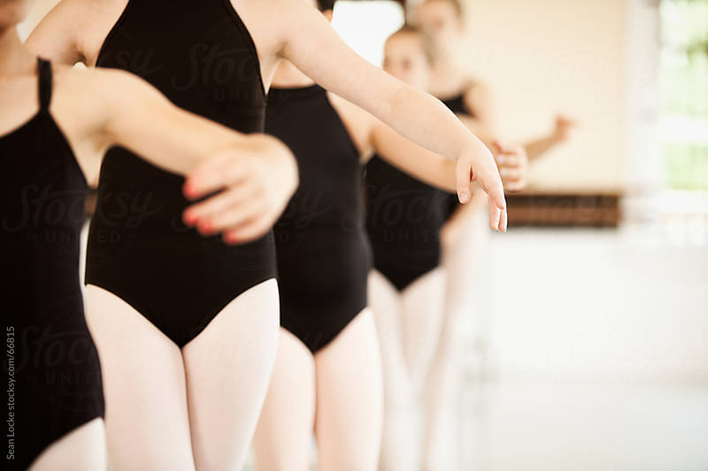 Ballet: Line of Girls Practicing Form by Sean Locke for Stocksy United