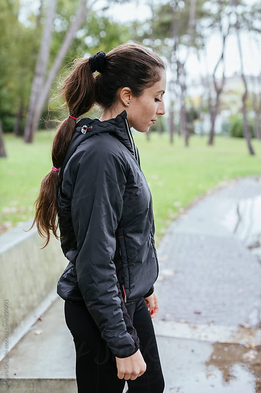 Woman during workout outdoor by Mauro Grigollo for Stocksy United