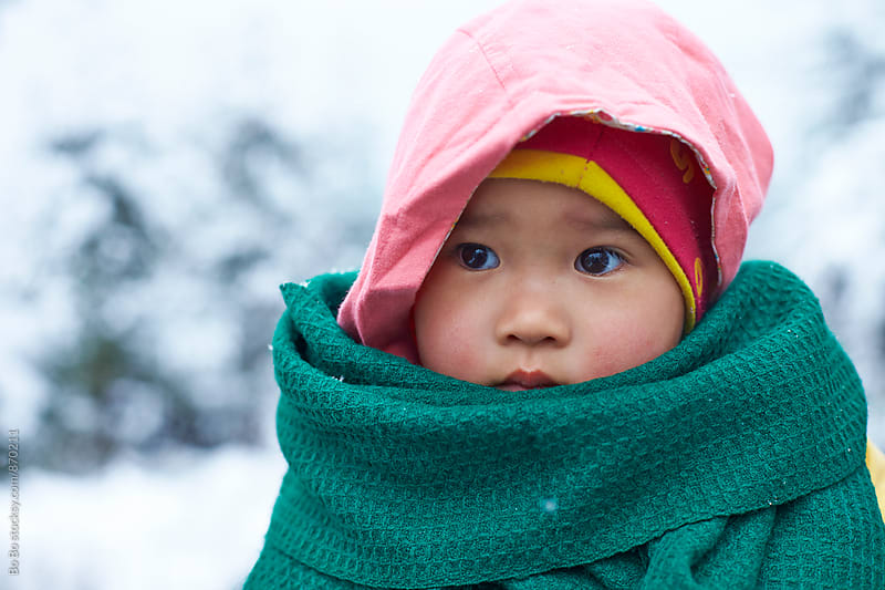 portrait of little asian girl in outdoor in the winter by Bo Bo for Stocksy United