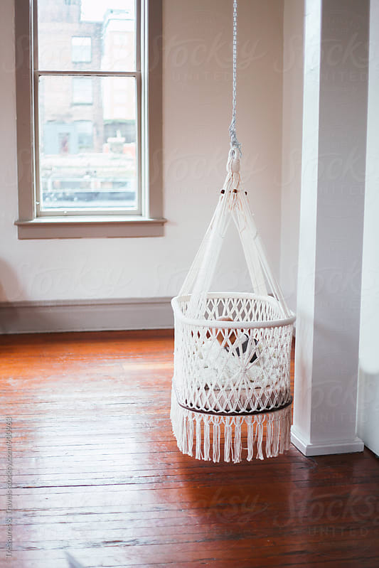 Hammock Crib Hanging in an empty room by Treasures & Travels for Stocksy United
