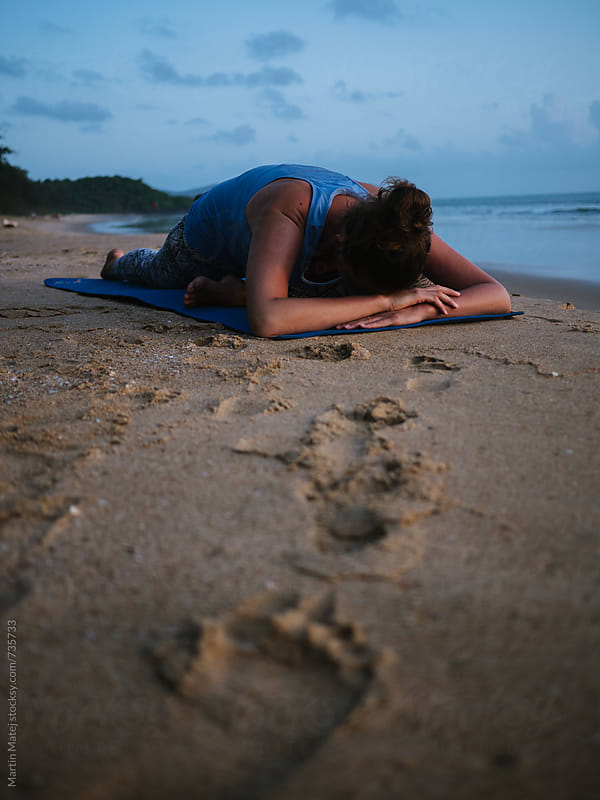 Yoga on the beach by Martin Matej for Stocksy United