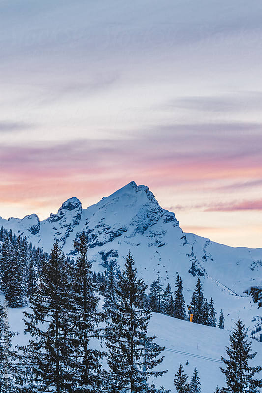 sunrise over snowcovered austrian mountain scenery by Leander Nardin for Stocksy United