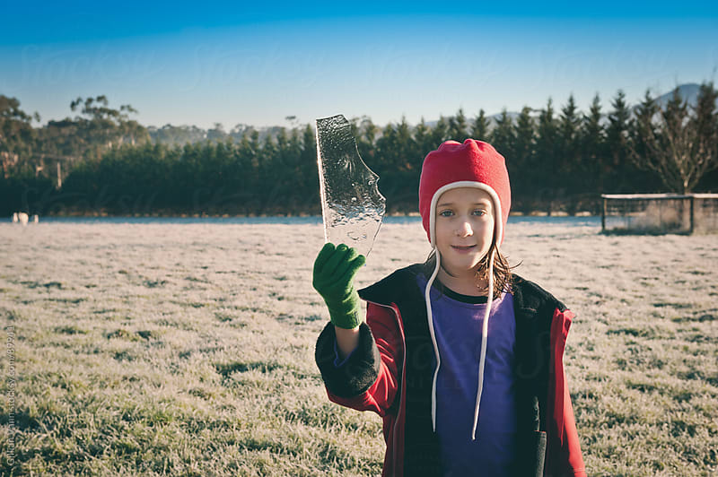girl with ice, winter on the farm by Gillian Vann for Stocksy United