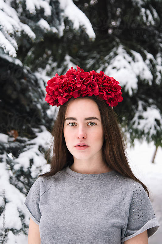 Attractive young woman wearing red wreath made of faux flowers by Danil Nevsky for Stocksy United