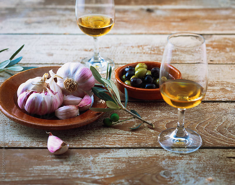 Fresh garlic, olives and sherry by J.R. PHOTOGRAPHY for Stocksy United