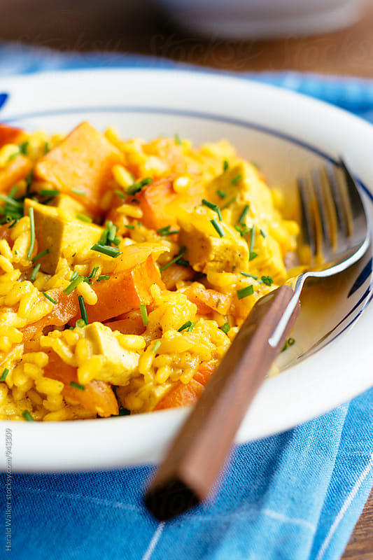 Orange Risotto with Tofu, Pumpkin and Apricot by Harald Walker for Stocksy United