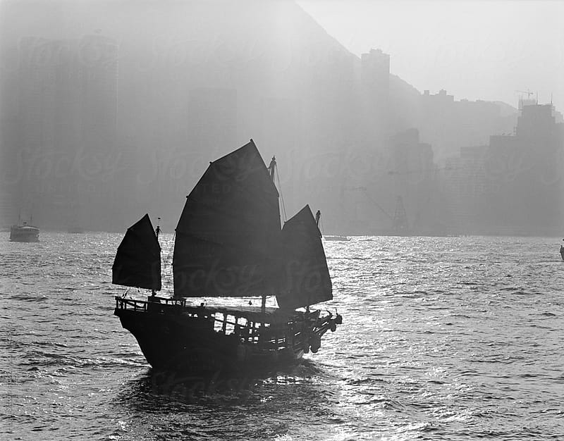 Chinese junk in Hong Kong harbour. HK China. by Hugh Sitton for Stocksy United