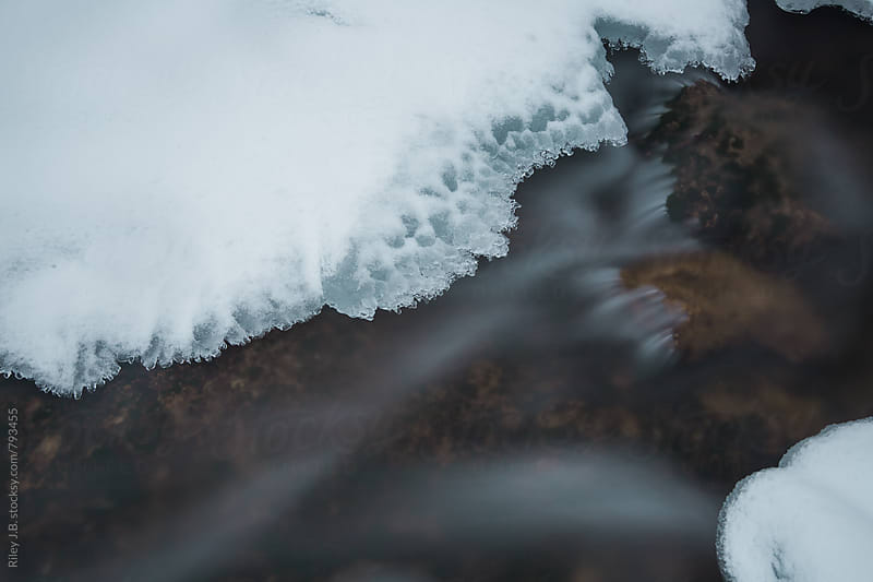 Long exposure of ice formed over a creek. by Riley J.B. for Stocksy United