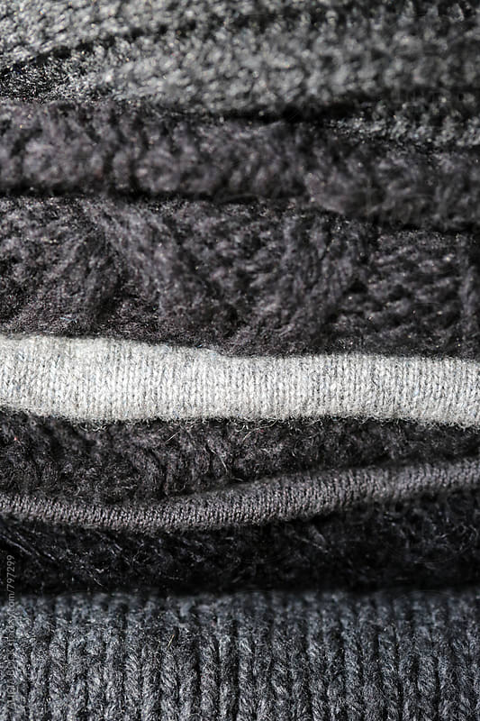 A Close Up Of A Pile Of Gray Winter Knit Sweaters by ALICIA BOCK for Stocksy United