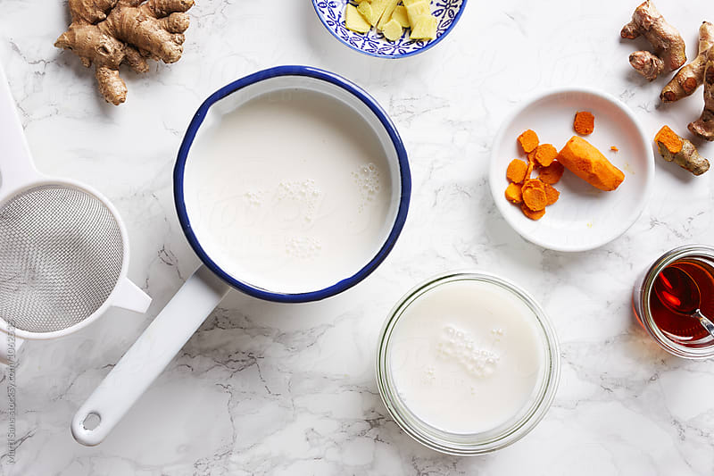 Vegetable almond milk in bowl and jar by Martí Sans for Stocksy United