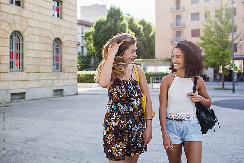 Two female friends spending time together in the city by michela ravasio for Stocksy United