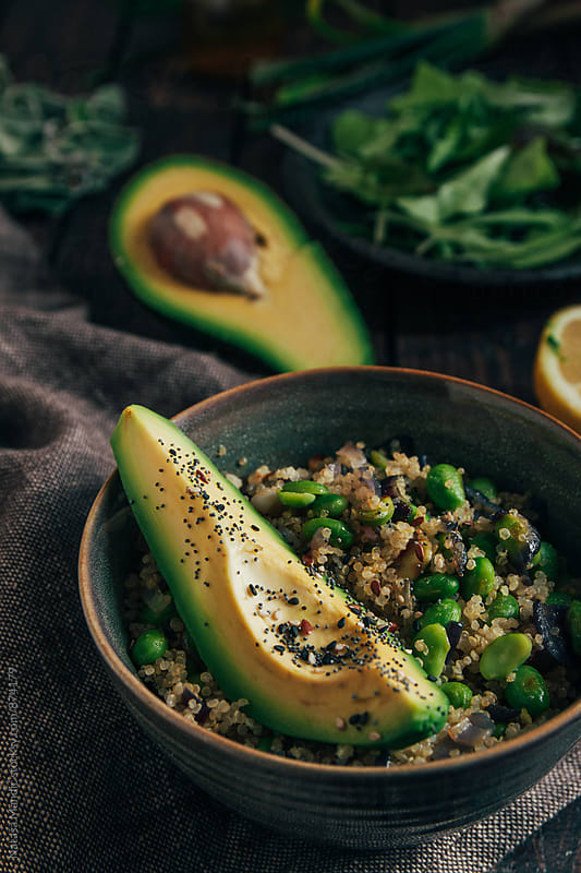 Quinoa with edamame, avocado and different kind of seeds by Nataša Mandić for Stocksy United