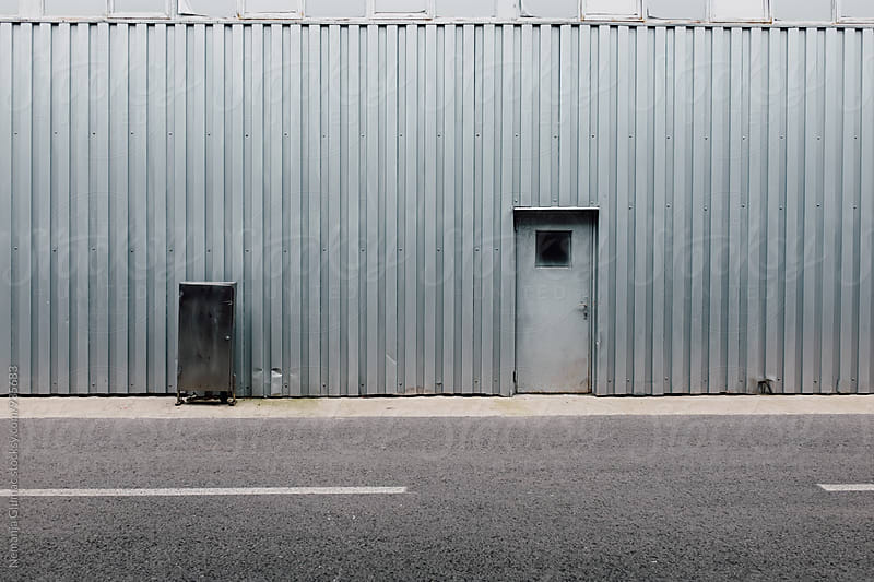 Corrugated Metal Wall With a Door by Nemanja Glumac for Stocksy United